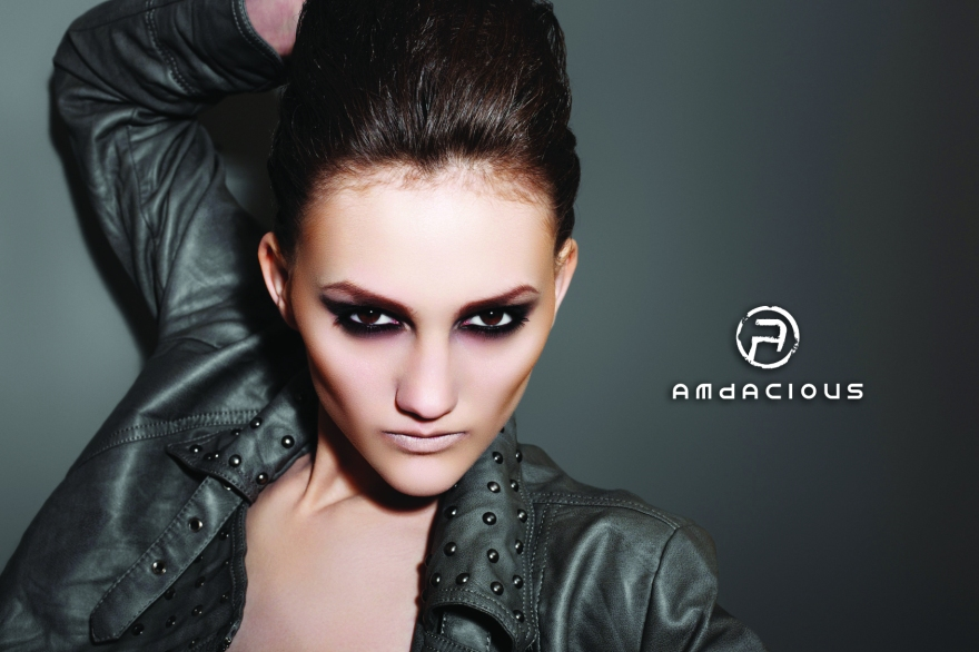 Fashion rock woman in leather jacket with dark evening make-up
